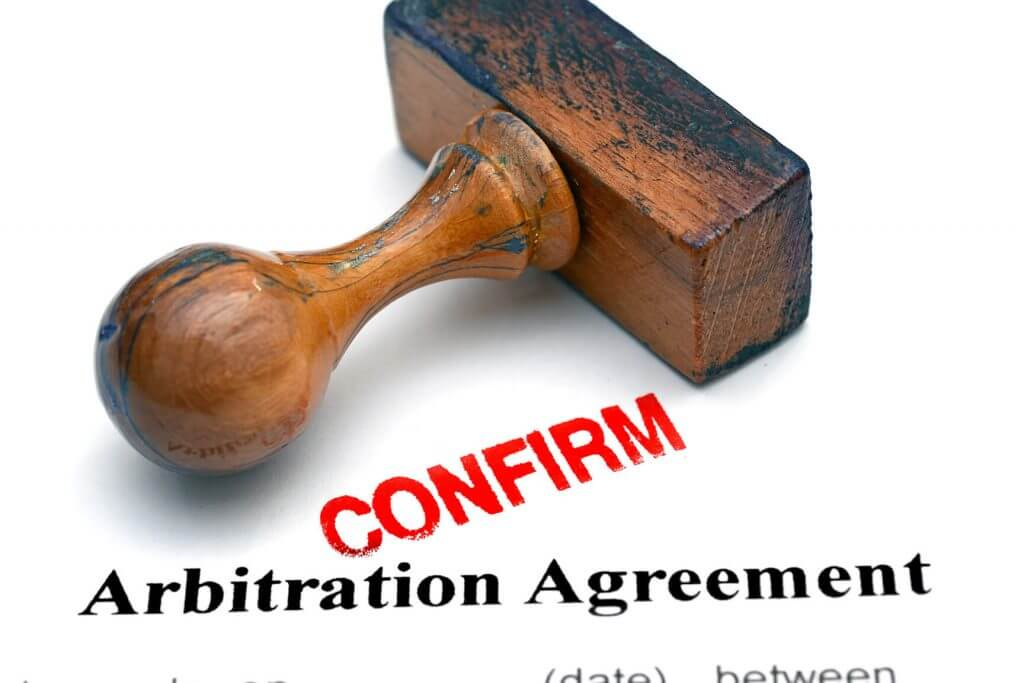 An Arbitration Agreement Document that has just been confirmed with a stamp.