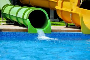 Green waterslide at a waterpark